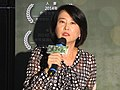 Wang Hong-wei with Song-of-the-Reed microphone 20150811.jpg