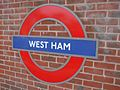 West Ham stn District roundel.JPG