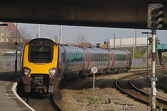 Weston-super-Mare railway station - CrossCountry unit 220014 departs with a service for Manchester Piccadilly.