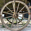 Wheel of an old horse carriage.jpg