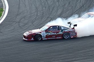 Nissan 180SX - Yoshinori Koguchi drifting a Nissan 180SX at D1 Grand Prix competition at Fuji Speedway in late-2007