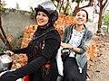 Young Women on Motorbike - Mwalamyine (Moulmein) - Myanmar (Burma) (11954063045).jpg