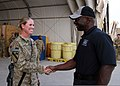 'Mad Max' Mullen presents a coin to Sgt. 1st Class Misty Cady.jpg