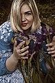 День Вишиванки. Молода україночка у вишитій синій сукні серед квітів 19.jpg