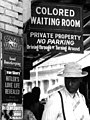 """""""COLORED WAITING ROOM"""" and """"HITLER'S LOVE LIFE REVEALED"""" - Jim Crow in Durham, North Carolina (cropped).jpg"""