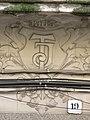 007 Casa Joan Tolrà, c. Enric Borràs 19 (Badalona), monograma.jpg