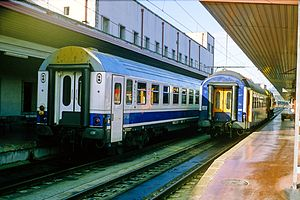 A Paris–Algeciras through coach (at right) being shunted at Irun railway station, Spain, 1993.