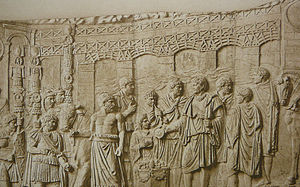 Trajan's Bridge - Relief of the bridge on Trajan's Column showing the unusually flat segmental arches on high-rising concrete piers; in the foreground emperor Trajan sacrificing by the Danube