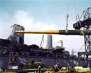 "16""/50 caliber Mark 7 gun - Yard workers hoist one of nine 16""/50 Mark VII gun barrels aboard the USS Iowa during her construction in 1942."