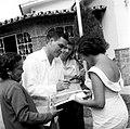1958. Wolfgang Larrazábal, candidato a la presidencia de la República, firmando autógrafos a damas no identificadas.jpg
