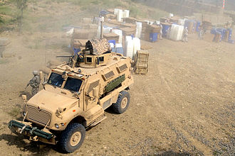 2009 Afghan presidential election - Armored US military trucks distributing ballot boxes.