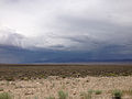 2014-07-28 12 36 27 View north across Ione Valley from Nye County Route 21 towards thunderstorms over the Shoshone Mountains in Nye County, Nevada.JPG