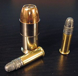 .22 Long Rifle - Two .22 LR rounds compared to a .45 ACP cartridge