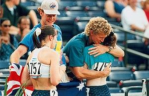 Chris Nunn -  Australian athletics coaches Brett Jones (left) and Chris Nunn congratulate athletes Lisa Llorens (left, bronze medallist) and Sharon Rackham (gold medallist) after the T20 200m at the 1996 Summer Paralympics