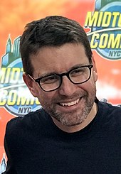 The film's co-writer Rhett Reese smiling at a 2018 event