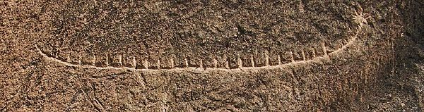 The reed boat petroglyph at Gobustan. 8-pointed star on the boat in Qobustan.jpg