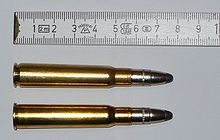 Two bullets side by side for comparison with a tape measure for scale.