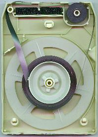 8-track tape - The inside of an 8-track cartridge. The black rubber pinch roller is at upper right.