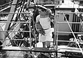 A French sailor carrying fresh pineapples on board the submarine depot ship HMS MERCATOR at Freetown, Sierra Leone, August 1943. A18857.jpg