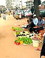 A Nigerian woman selling garden eggs and groundnuts.jpeg
