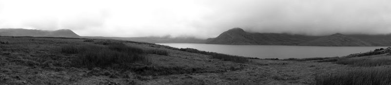 A black and white panoramic photograph of a lake in the Andes Mountains.jpeg