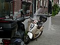 A close-up of two parked mopeds in the street Hoogtekadijk, Amsterdam-city; high resolution image by FotoDutch, June 2013.jpg