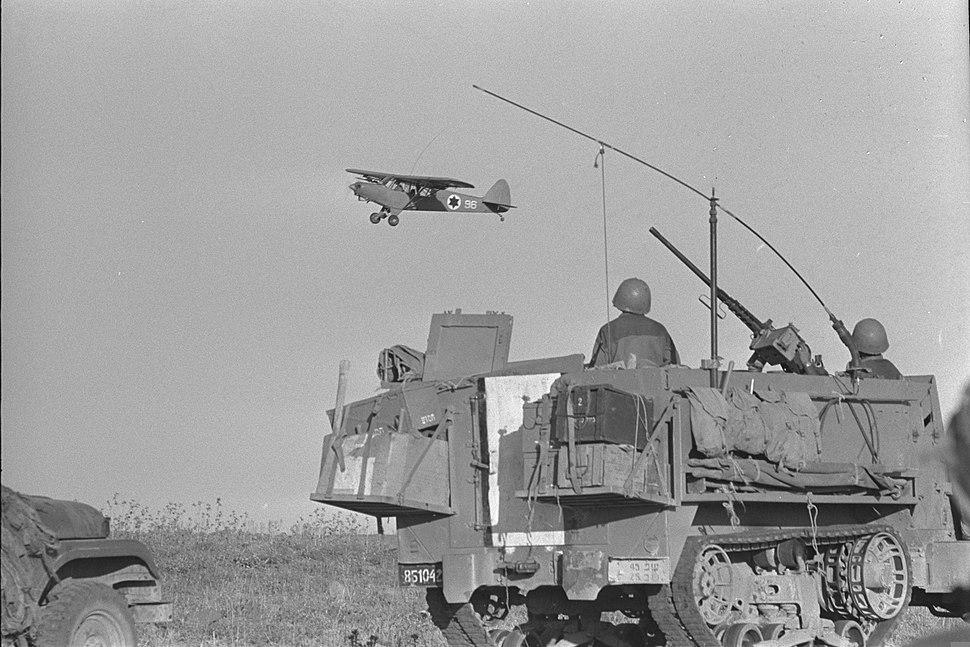 A light Israeli observation plane over-flying Israeli units advancing on the Golan plateau. June 1967. D327-113