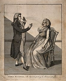 220px A man hypnotising a woman using the animal magnetism method. Wellcome V0016620