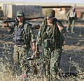 A pair of YPJ fighters with their weapons.jpg