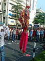 A stilt walker at Shahbag , Dhaka 3.jpg