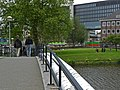 A view over the concrete bow of the foot and bicycle bridge, and the university campus on Roeterseiland, Amsterdam; high resolution image by FotoDutch in June 2013..jpg