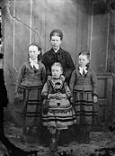 A woman and three girls NLW3364838.jpg