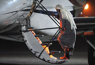Abu Qatada - Qatada boards a plane for deportation to Jordan.