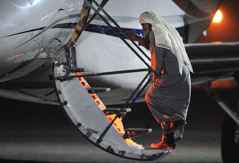 Abu Qatada boards plane.jpg