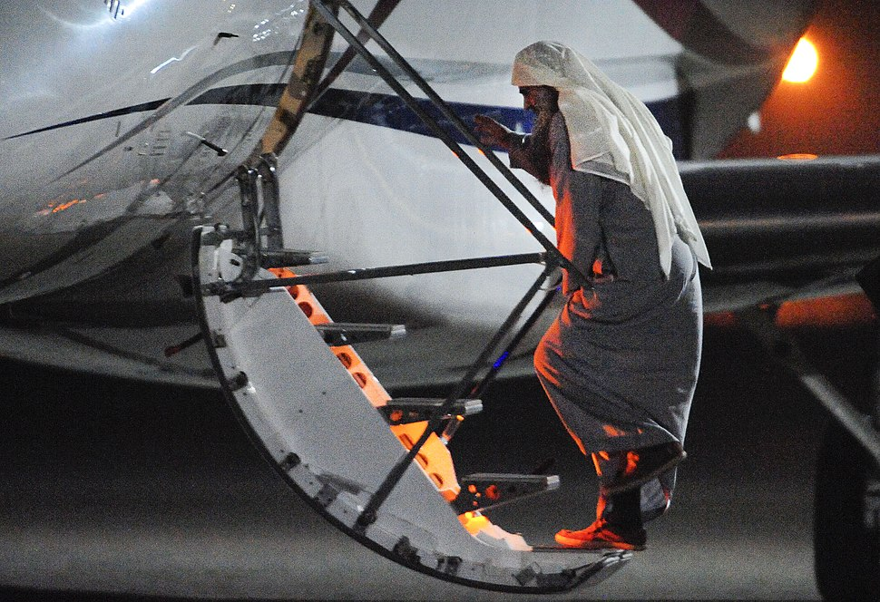 Abu Qatada boards plane