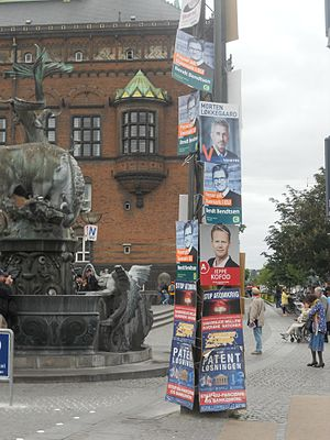 European Parliament election, 2014 (Denmark) - Electoral posters in Copenhagen in May 2014, for the European election. Posters for the Social Democrats, Conservatives, and Venstre appear here. The posters at the bottom relate to the referendum on a Unified Patent Court. On a lamppost in the background of the image, a poster for the People's Movement against the EU is also visible.