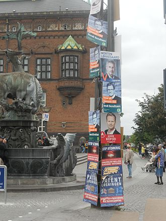 2014 European Parliament election in Denmark - Electoral posters in Copenhagen in May 2014, for the European election. Posters for the Social Democrats, Conservatives, and Venstre appear here. The posters at the bottom relate to the referendum on a Unified Patent Court. On a lamppost in the background of the image, a poster for the People's Movement against the EU is also visible.