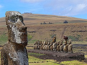 """Ahu Tongariki - Ahu Tongariki with volcano Poike in the background and the nearby """"Traveling Moai"""" in the foreground."""