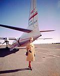 Air Hostess Uniform 1965 Gold 001 (9626673238).jpg