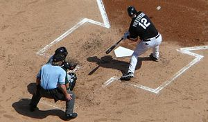 Checked swing - A. J. Pierzynski of the Chicago White Sox checks his swing on a low pitch.