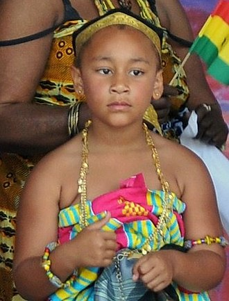 Ghanaian people - Ghanaian girl in traditional Ghanaian kente clothing and national costume.