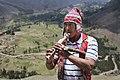 Amerindian man playing the Inca flute (30853282650).jpg