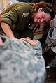 An Israeli Defense Forces soldier, top, applies mock wounds to a U.S. Soldier in preparation for an emergency response exercise during Austere Challenge 2012 in Beit Ezra, Israel 121022-F-QW942-029.jpg