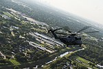 An MH-53E Sea Dragon helicopter flies over flooded areas of Houston, Texas. (37044693285).jpg
