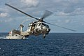 An MH-60S Sea Hawk helicopter assigned to Helicopter Sea Combat Squadron (HSC) 25 returns to the Military Sealift Command dry cargo and ammunition ship USNS Washington Chambers (T-AKE 11).JPG