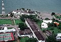 An aerial view which includes the officers club, near water, and the Mubahay bachelor officers quarters and adjacent tennis courts - DPLA - 2a7dda803aa5b015b8c9c5704d3a5c31.jpeg