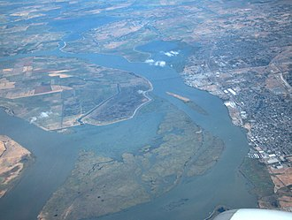 Sherman Island (California) - Sherman Island, on left and in foreground, lies north of the city of Antioch, California (on the right). The two are connected by the Antioch Bridge. Sherman Lake lies between the southwestern extent of Sherman Island, in the foreground, and the remainder of Sherman Island.