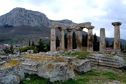 The Temple of Apollo at Corinth, built c. 540 BC, with the Acrocorinth (i.e. the acropolis of Corinth that once held a Macedonian garrison) seen in the background Apollon Tempel im antiken Korinth.jpg