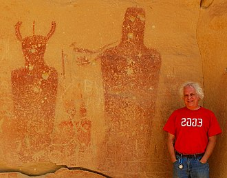 Kenneth Feder - Feder stands in front of ancient pictographs at Sego Canyon in Utah.