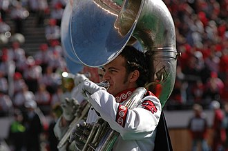 Goin' Band from Raiderland - A band member plays a sousaphone.